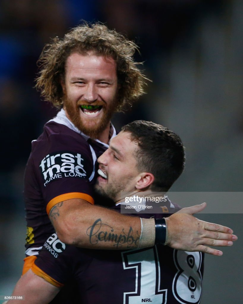 Korbin Sims of the Broncos congratulates Corey Oates on scoring a try during the round 22 NRL match between the Gold Coast Titans and the Brisbane Broncos at Cbus Super Stadium on August 5, 2017 in Gold Coast, Australia.