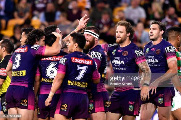 Korbin Sims of the Broncos is congratulated by team mates after scoring a try during the round 23 NRL match between the Brisbane Broncos and the...