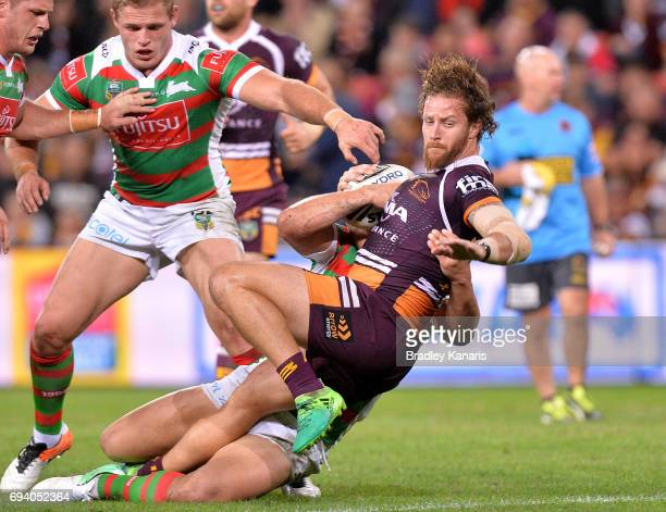 Korbin Sims of the Broncos is tackled during the round 14 NRL match between the Brisbane Broncos and the South Sydney Rabbitohs at Suncorp Stadium on...