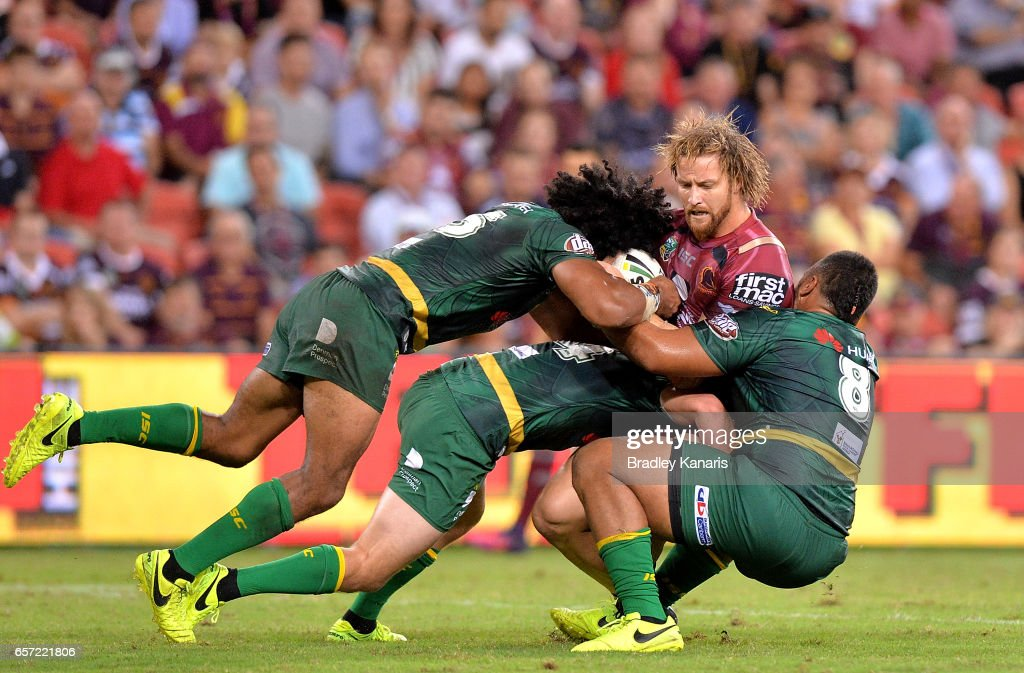 Korbin Sims of the Broncos is tackled during the round four NRL match between the Brisbane Broncos and the Canberra Raiders at Suncorp Stadium on March 24, 2017 in Brisbane, Australia.