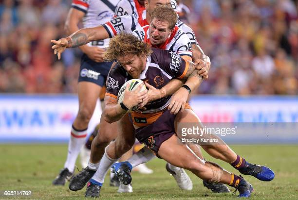Korbin Sims of the Broncos pushes his way through the defence before going on to score a try during the round six NRL match between the Brisbane...