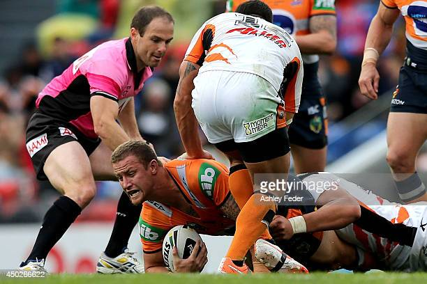 Korbin Sims of the Knights is tackled during the round 13 NRL match between the Newcastle Knights and the Wests Tigers at Hunter Stadium on June 8...