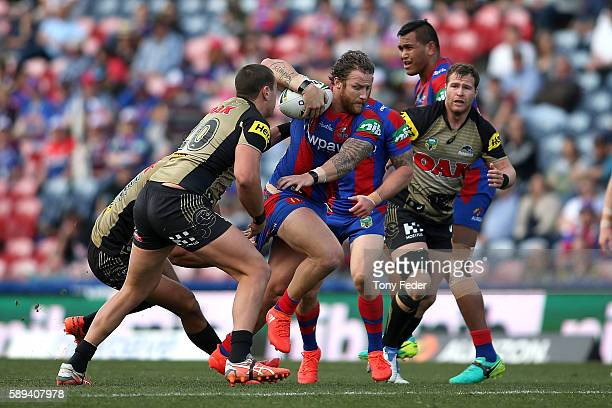 Korbin Sims of the Knights runs the ball during the round 23 NRL match between the Newcastle Knights and the Penrith Panthers at Hunter Stadium on...