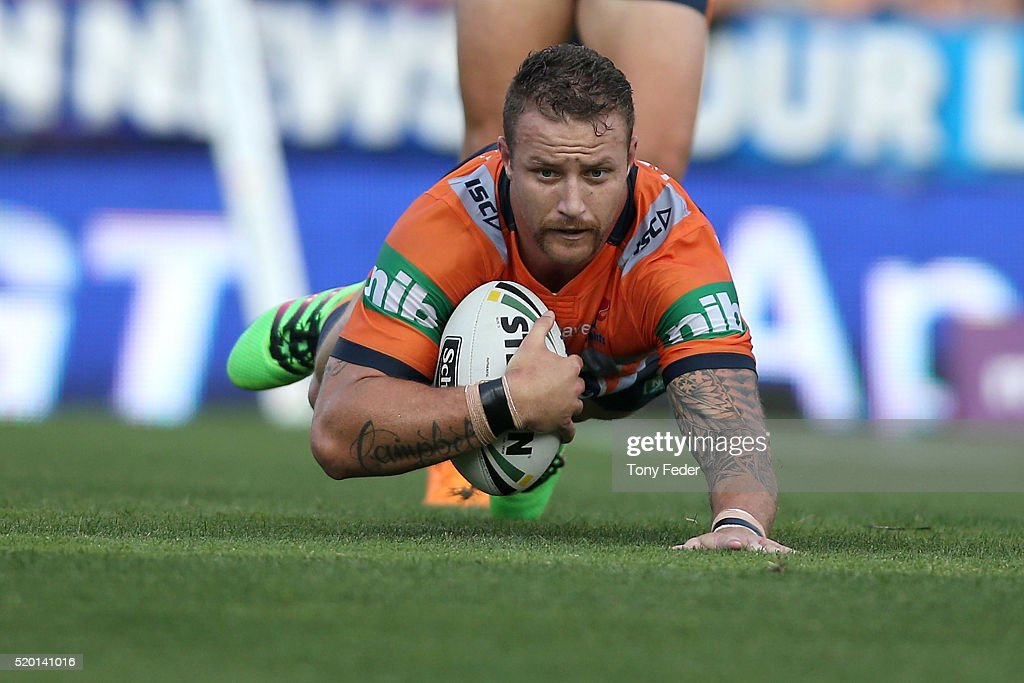 Korbin Sims of the Knights scores a try during the round six NRL match between the Newcastle Knights and the Wests Tigers at Hunter Stadium on April 10, 2016 in Newcastle, Australia.