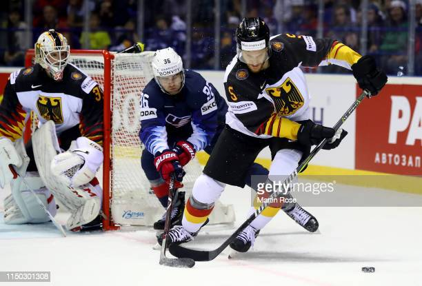 Korbinian Holzer of Germany challenges Colin White of United States during the 2019 IIHF Ice Hockey World Championship Slovakia group A game between...