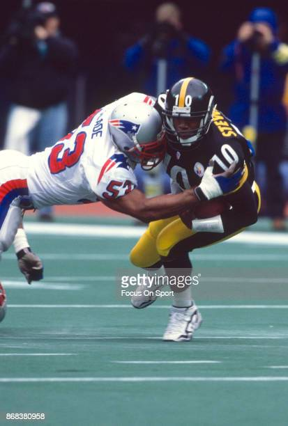 Kordell Stewart of the Pittsburgh Steelers gets tackled by Chris Slade of the New England Patriots during an NFL football game circa 1996 at Three...