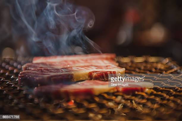 Korea, Bacon slices on barbecue grill