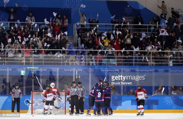 Korea celebrates a goal scored by Randi Griffin of Korea in the second period against Japan during the Women's Ice Hockey Preliminary Round Group B...
