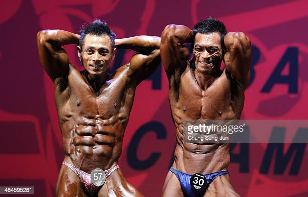 Korea Champion Kwon YoungDoo and Park HyunWook performs in the WFF Men Class Two competition during the 2014 NABBA/WFF Korea Championship on April 13...