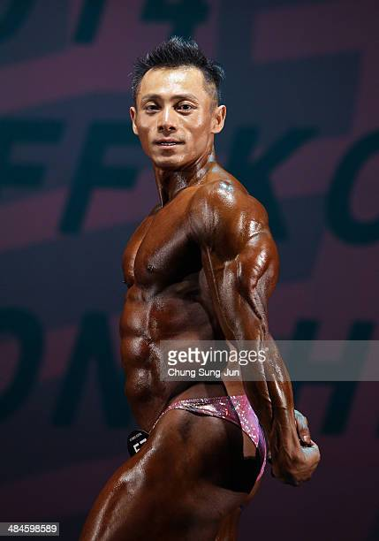 Korea Champion Kwon YoungDoo perform in the WFF Overall competition during the 2014 NABBA/WFF Korea Championship on April 13 2014 in Daegu South Korea