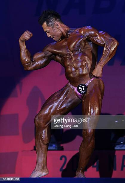 Korea Champion Kwon YoungDoo performs in the WFF Men Class Two competition during the 2014 NABBA/WFF Korea Championship on April 13 2014 in Daegu...