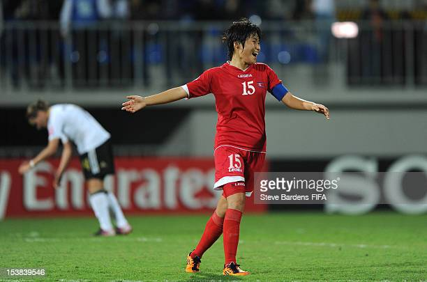 Korea DPR Captain Chung Bok Choe celebrates victory at the final whistle of the FIFA U17 Women's World Cup 2012 SemiFinal match between Korea DPR and...