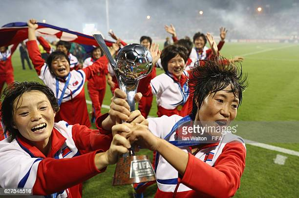 Korea DPR players celebrat with the trophy after winning the FIFA U-20 Women's World Cup, Final match between Korea DPRand France at the National...