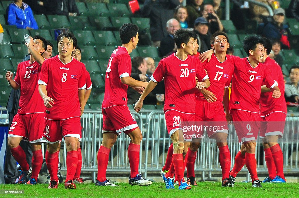 Korea DPR players celebrate during the 2013 EAFF East Asian Cup Qualifying match between Korea DPR and Australia at Hong Kong Stadium on December 5, 2012 in So Kon Po, Hong Kong.