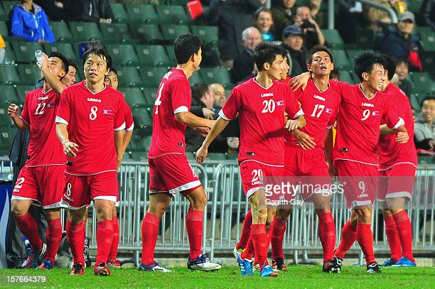 Korea DPR players celebrate during the 2013 EAFF East Asian Cup Qualifying match between Korea DPR and Australia at Hong Kong Stadium on December 5...
