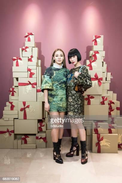 Korea Fashion Influencer Harin Lee and Japanese DJ and Musician Yulia pose for a photograph on the red carpet at the Burberry Pacific Place event on...