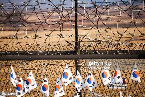 korea flags hang on fence at dmz area of south and north korea - korean demilitarized zone stock pictures, royalty-free photos & images