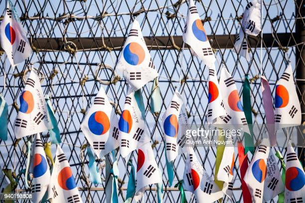 korea flags hang on fence at dmz area of south and north korea - national landmark stock pictures, royalty-free photos & images
