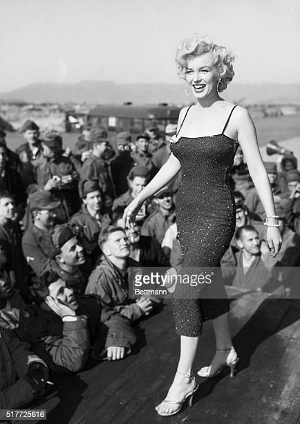 Korea: Heat wave, entertaining US troops in Korea. The walk and wiggle of Marilyn Monroe speak for themselves. The boys answer with whistles, cheers,...
