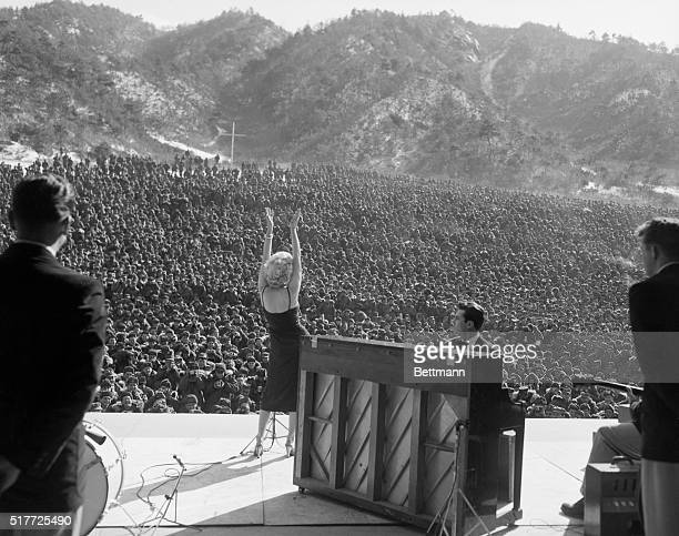 Heat wave Wherever she went the boys turned out for the show in the impressive numbers Here she faces a sea of GI's as she does a song SEENOTE