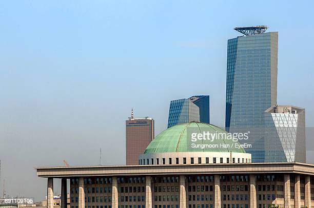 korea national assembly building against clear sky in city - east asia stock pictures, royalty-free photos & images