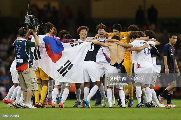 Korea players celebrate after defeating Japan during the Men's Football Bronze medal playoff match between Korea and Japan on Day 14 of the London...