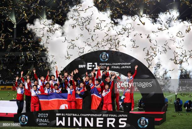 Korea players celebrate their victory after the EAFF E-1 Women's Football Championship Fina between Japan and North Korea at Fukuda Denshi Arena on...