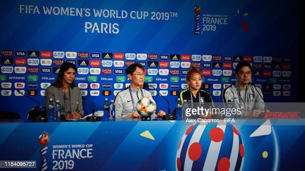 Korea Rebuplic coach Dukyeo Yoon and Sohyun Cho of Korea Republic face the media during a press conference at Parc des Princes stadium on June 06,...