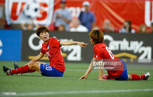 Korea Republic defender Kim Hyeri and Korea Republic defender Lim Seonjoo lay on the ground after a shot by the US Womens National team during the...