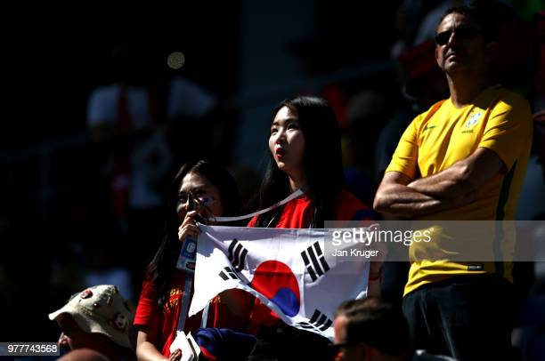 Korea Republic fan enjoys the pre match atmosphere prior to the 2018 FIFA World Cup Russia group F match between Sweden and Korea Republic at Nizhniy...