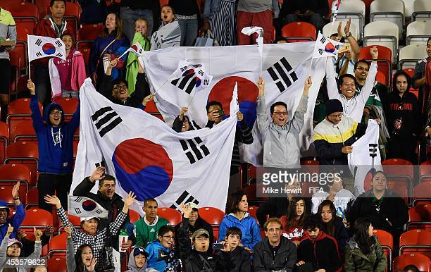 Korea Republic fans celebrate their victory in the FIFA U20 Women's World Cup Canada 2014 Group D match between Korea Republic and Mexico at the...