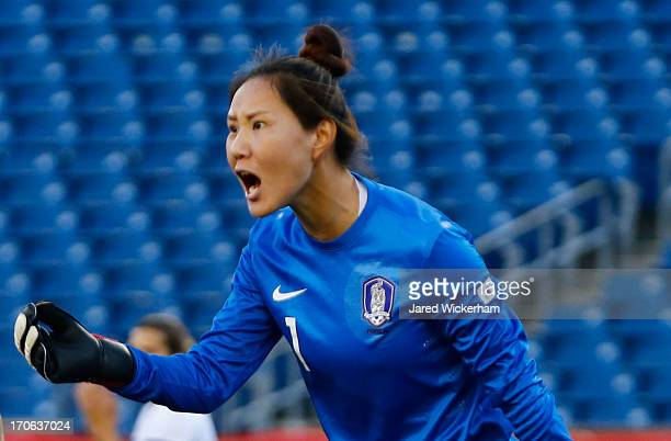Korea Republic goalkeeper Kim Jungmi yells to her teammates in the first half against the US Womens National team during the game at Gillette Stadium...