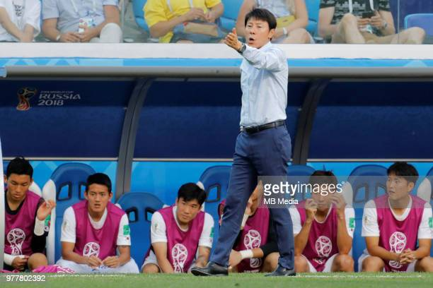 Korea Republic national team head coach Taeyong Shin gestures during the 2018 FIFA World Cup Russia group F match between Sweden and Korea Republic...