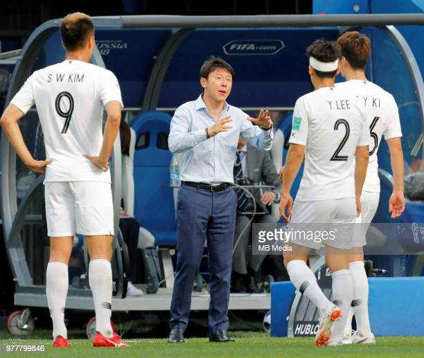 Korea Republic national team head coach Taeyong Shin talks to his players during the 2018 FIFA World Cup Russia group F match between Sweden and...