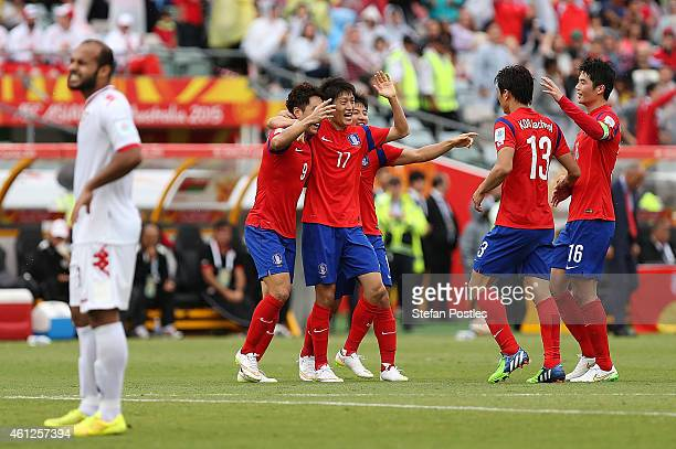 Korea Republic players celebrate after a goal by Cho Young Cheol during the 20145 Asian Cup match between Korea Republic and Oman at Canberra Stadium...