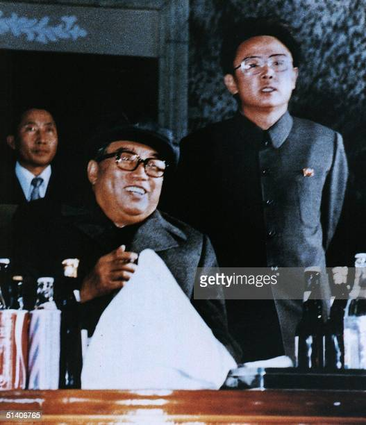 File photo released by the Korea News Service dated October 1980 shows North Korean leader Kim JongIl and father Kim IlSung attending an evening...