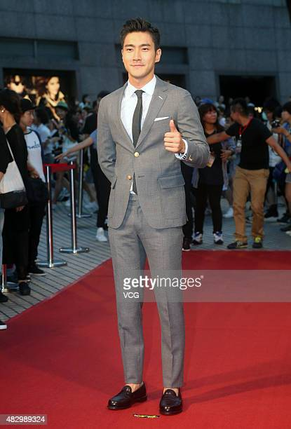 Korean actor Choi Siwon poses on red carpet during the press conference of Dante Lam's film To The Force on August 4 2015 in Taipei Taiwan of China