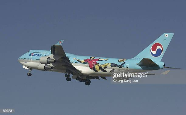 Korean Air aircraft takes off with a new logo design of the 2002 Federation Internationale de Football Association World Cup February 7 2002 in Seoul...