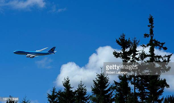 Korean Air Cargo Boeing 7478 Intercontinental jet flies by the TPC Snoqualmie Ridge before the start of round one of the Boeing Classic at TPC...