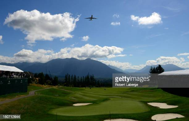 Korean Air Cargo Boeing 7478 Intercontinental jet flies over the 18th green of the TPC Snoqualmie Ridge before the start of round one of the Boeing...