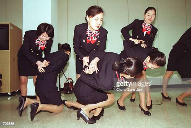 Korean Air flight crew demonstrates a mock antiterrorist drill at a training institute March 21 2002 in Seoul Korean Air announced March 21 2002 that...