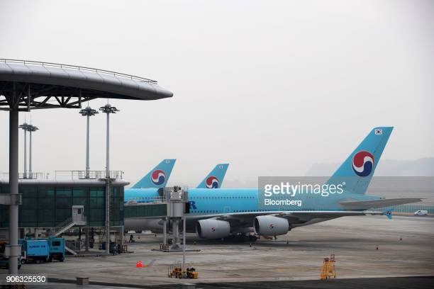 Korean Air Lines Co aircrafts stand on the tarmac outside the terminal 2 building at Incheon International Airport in Incheon South Korea on Thursday...