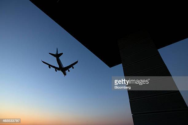A Korean Air Lines Co passenger aircraft approaches to land at Incheon International Airport in Incheon South Korea on Sunday Jan 26 2014 Korean Air...