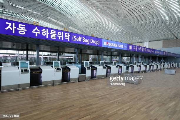 A Korean Air Lines Co selfservice bagdrop counter is seen inside the nearly completed terminal 2 building during a media preview at Incheon...