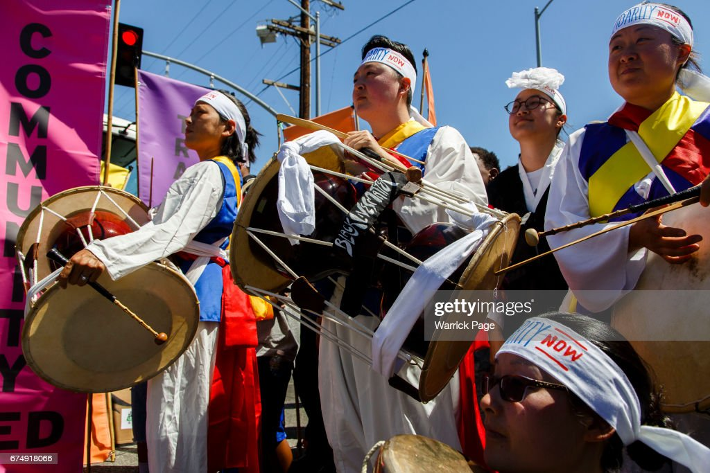 Korean American musicians gather to perform at a peace rally at the intersection of Florence and Normandie, on the 25th anniversary of the LA riots, on April 29, 2017 in Los Angeles, California. Florence and Normandie was the flashpoint for the riots that was sparked by the police acquittals in the Rodney King beating.