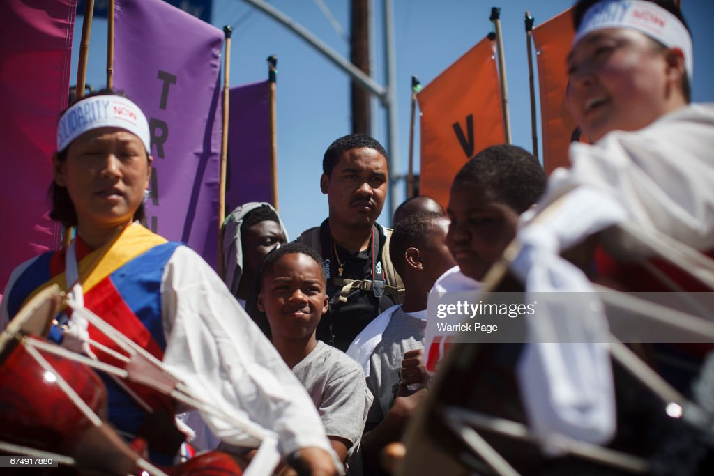 Korean and African Americans gather at a peace rally at the intersection of Florence and Normandie, on the 25th anniversary of the LA riots, on April 29, 2017 in Los Angeles, California. Florence and Normandie was the flashpoint for the riots that was sparked by the police acquittals in the Rodney King beating.
