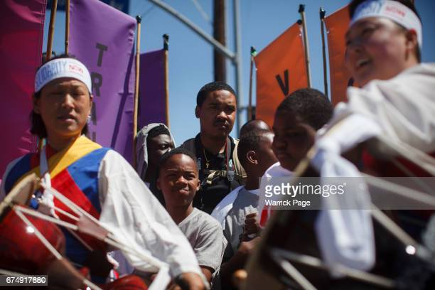 Korean and African Americans gather at a peace rally at the intersection of Florence and Normandie on the 25th anniversary of the LA riots on April...