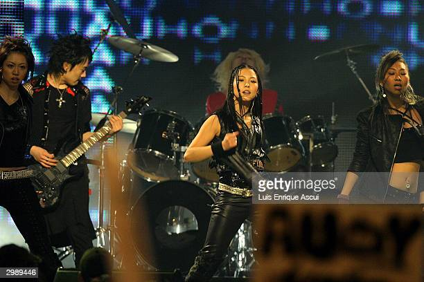 """Korean artist BoA performs on stage at the """"MTV Asia Awards 2004"""" at the Singapore Indoor Stadium on February 14, 2004 in Singapore. The third annual..."""
