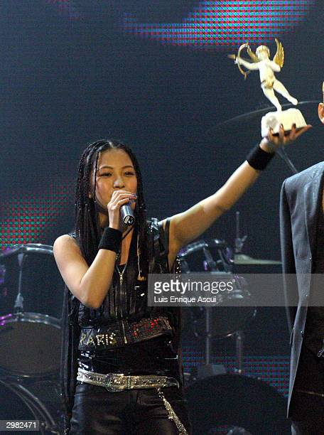 Korean artist BoA recieves her award on stage at the MTV Asia Awards 2004 at the Singapore Indoor Stadium on February 14 2004 in Singapore The third...