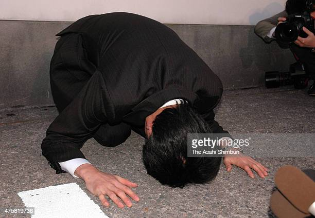 Korean barbeque restaurant chain 'Yakiniku Zakaya Ebisu' operator Foods Forus President Yasuhiro Kanzaka kneels down on the ground for apology on May...
